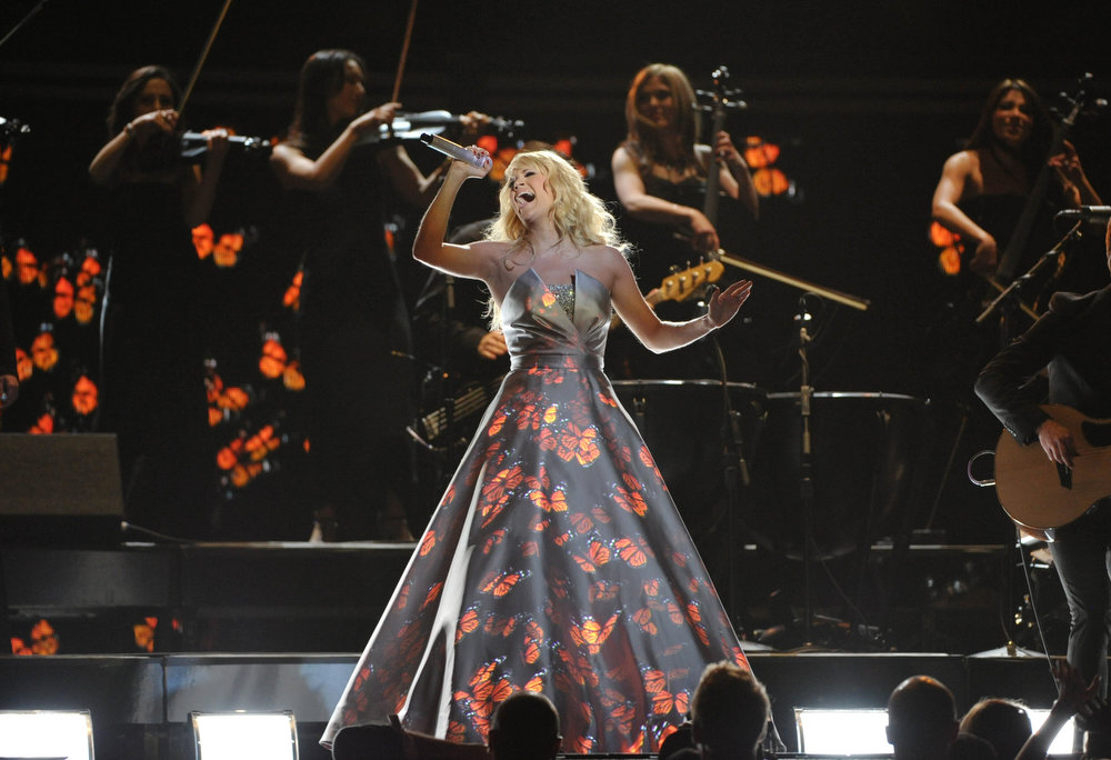 Description of . Carrie Underwood performs on stage at the 55th annual Grammy Awards on Sunday, Feb. 10, 2013, in Los Angeles. (Photo by John Shearer/Invision/AP)