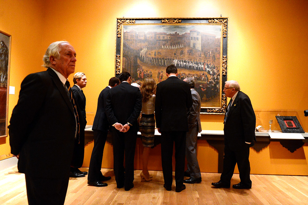 . Professor Steven Hackel shows The Crown Prince Felipe and Princess Letizia of Spain and their Spanish entourage the Junipero Serra exhibition at The Huntington Library in San Marino Saturday night, November 16, 2013. (Photo by Sarah Reingewirtz/Pasadena Star-News)