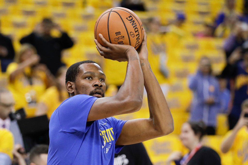 . Golden State Warriors forward Kevin Durant warms up before Game 1 of basketball\'s NBA Finals between the Warriors and the Cleveland Cavaliers in Oakland, Calif., Thursday, May 31, 2018. (AP Photo/Marcio Jose Sanchez)
