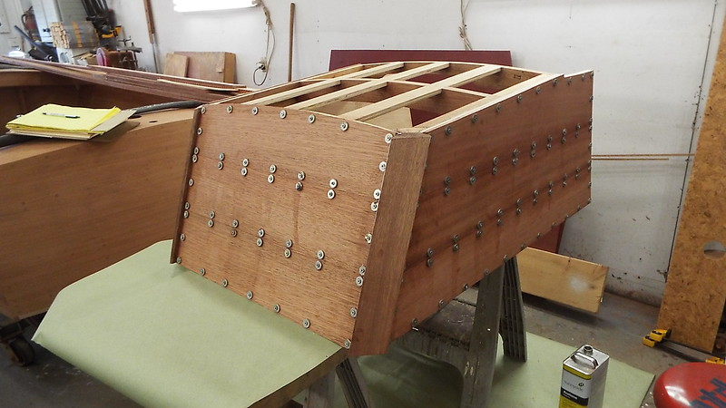 Starboard side and rear of engine box planked. Planks are held in place with temporary fasteners.