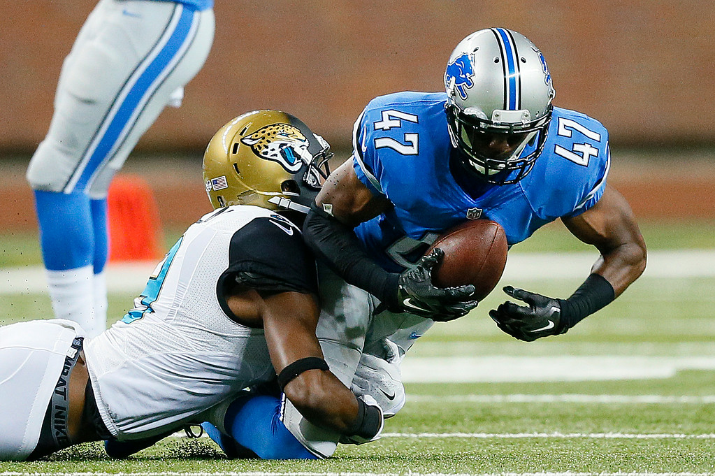 . Detroit Lions defensive back Nate Ness (47) intercepts a pass as Jacksonville Jaguars wide receiver Ramses Barden (9) brings him down in the second half of a preseason NFL football game at Ford Field in Detroit, Friday, Aug. 22, 2014. (AP Photo/Rick Osentoski)