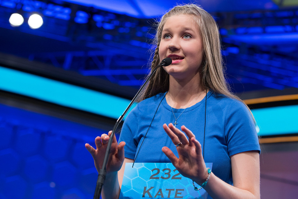 ". Kate Miller, 14, of Abilene, Texas, spells the word ""osteochondrous\"" correctly during the final round of the National Spelling Bee, on Thursday, May 29, 2014, in Oxon Hill, Md. (AP Photo/Evan Vucci)"