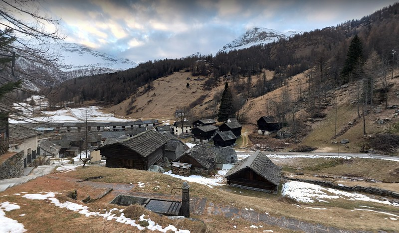 View on some cabins of Bosco Gurin from the town church. Source: Google Maps