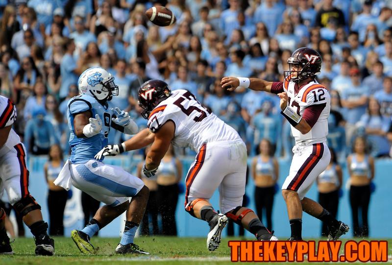 Virginia Tech Hokies quarterback Michael Brewer (12) throws a pass down field. (Michael Shroyer/ Thekeyplay.com)