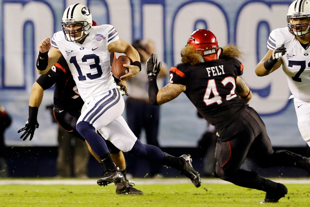 . BYU quarterback Riley Nelson scrambles for a 13-yard gain and a first down against San Diego State during the first half of the Poinsettia Bowl NCAA college football game, Thursday, Dec. 20, 2012, in San Diego. (AP Photo/Lenny Ignelzi)