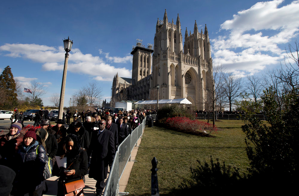 . People leave the Washington National Cathedral in Washington, Tuesday, Jan. 22, 2013, after the National Prayer Service, attended by President Barack Obama and Vice President Joe Biden, and their spouses. The 106-year-old Episcopal church has long hosted presidential inaugural services., this one following Monday\'s 57th Presidential Inauguration.    (AP Photo/Manuel Balce Ceneta)