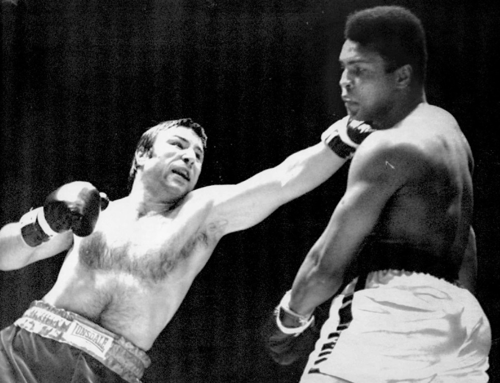 . Chuvalo Scores With  A Left - George Chuvalo, Canadian heavyweight champion, connects with a left to the head of Muhammad Ali, former heavyweight champion in action in the first round of their scheduled 12-round fight at Vancouver\'s Pacific Coliseum Monday night. 1972. Denver Post Library photo archive