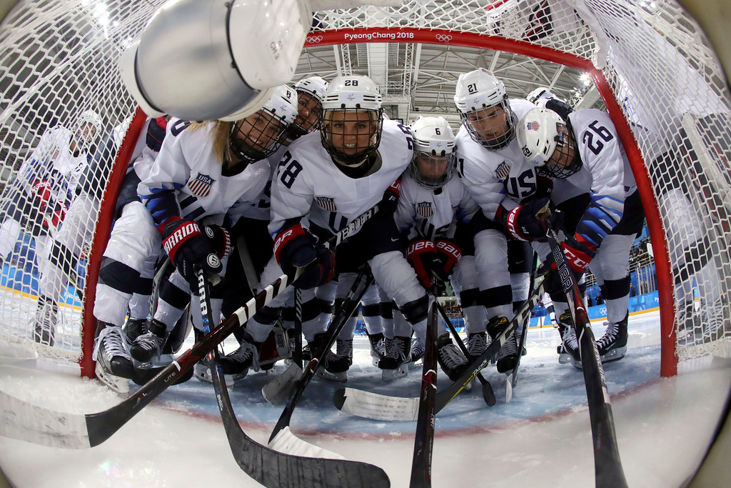 . Players from the United States pose for a camera inside the goal net before the preliminary round of the women\'s hockey game against Finland at the 2018 Winter Olympics in Gangneung, South Korea, Sunday, Feb. 11, 2018. (Ronald Martinez/Pool Photo via AP)