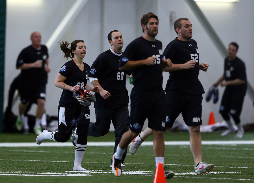 . Lauren Silberman warms up before she participates in NFL Regional Scouting Combine on March 3, 2013 at the Atlantic Health Training Center in Floram Park, New Jersey. Silberman is the first female to try out for the NFL.  (Photo by Elsa/Getty Images)
