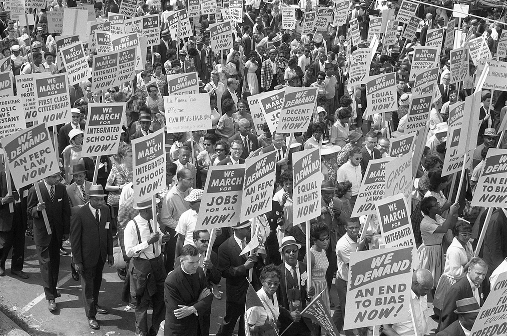 Description of . Demonstrators marching in the street holding signs during the March on Washington. Aug. 28, 1963. (Marion S. Trikosko - Library of Congress Prints and Photographs Division)