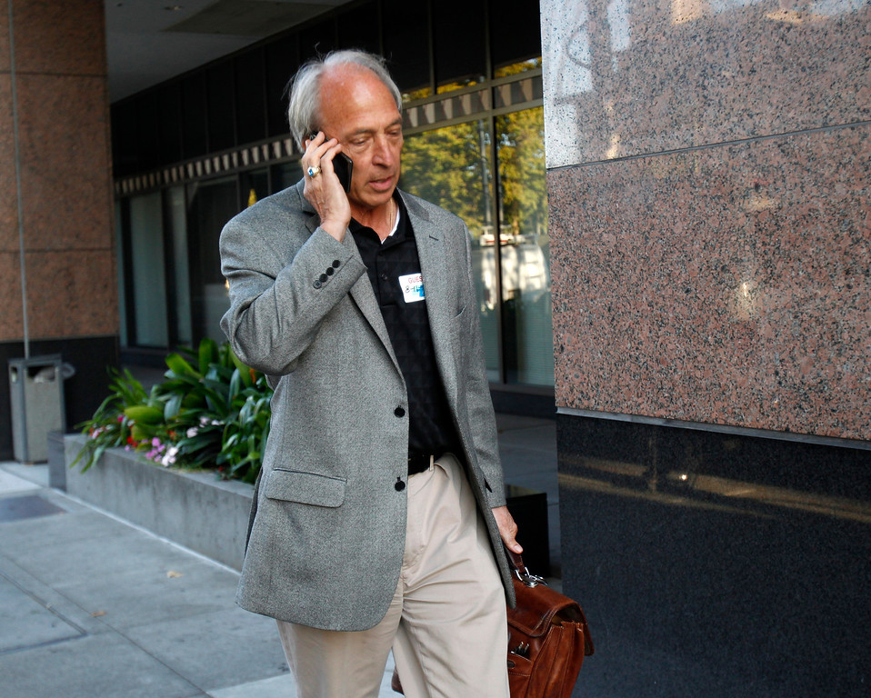 . Tom Hock, chief negotiator for BART, heads into the Caltrans offices in downtown Oakland, Calif., on Sunday, Aug. 11, 2013.  (Nhat V. Meyer/Bay Area News Group)