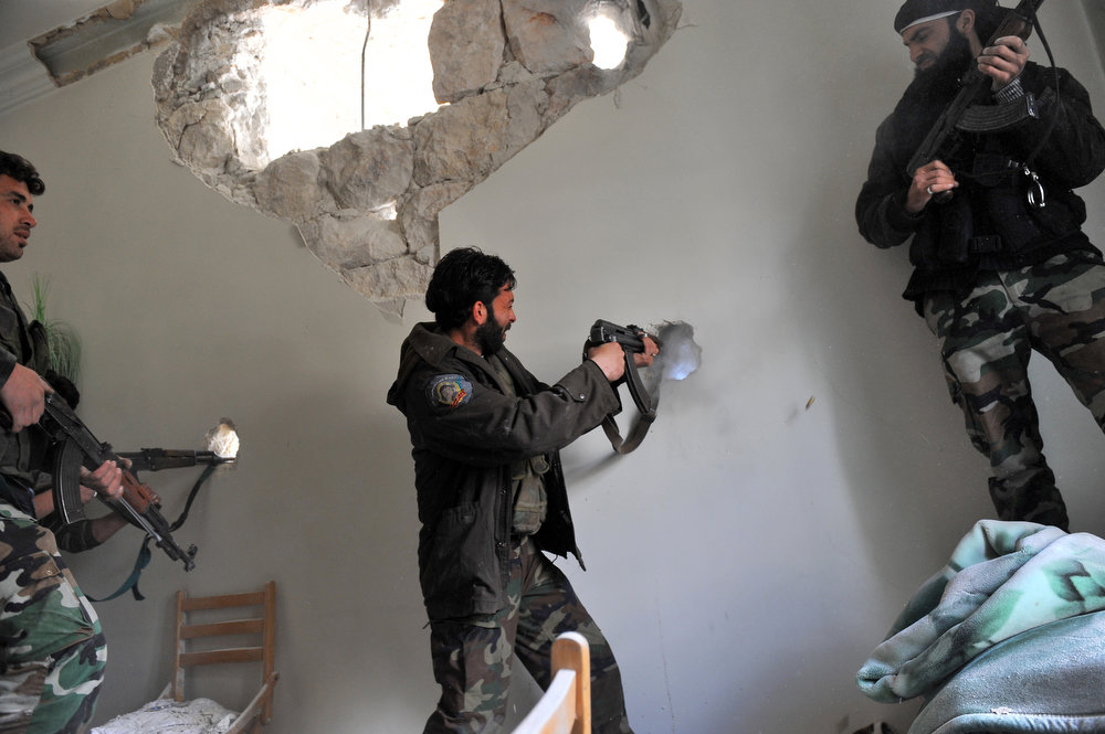 . Rebels clash with Syrian government forces at Saif al-Dawla district in the northern Syrian city of Aleppo on March 23, 2013. In Aleppo, nine months into fighting that has devastated many districts, life has slowly started to return to what passes for normal in Syria today. BULENT KILIC/AFP/Getty Images