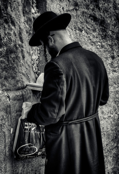 Man praying at the wailing wall.