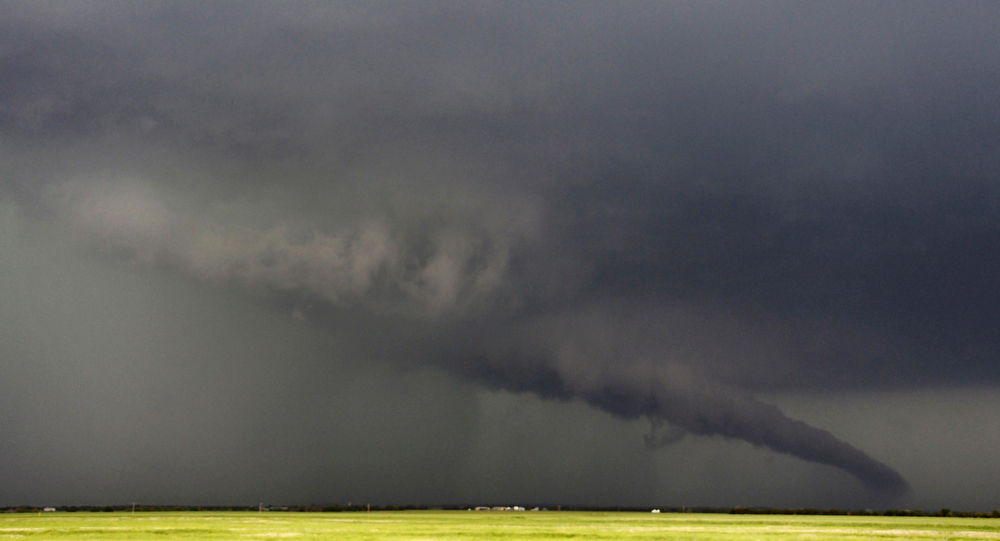 Description of . The funnel of a tornadic thunderstorm almost touches the ground near South Haven, in Kansas May 19, 2013. A massive storm front swept north through the central United States on Sunday, hammering the region with fist-sized hail, blinding rain and tornadoes, including a half-mile wide twister that struck near Oklahoma City. News reports said at least one person had died. REUTERS/Gene Blevins