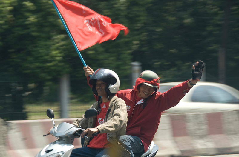 Friendly wave from motorcycle-riding protester in Thailand