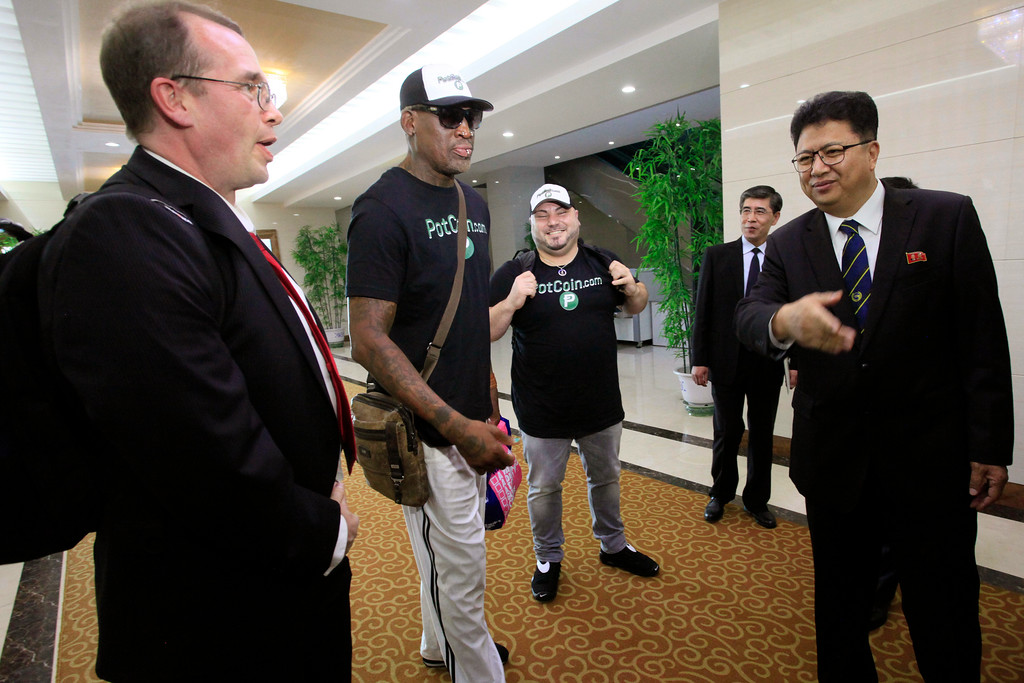 . Former NBA basketball star Dennis Rodman, center,  is greeted by North Korea\'s Sports Ministry Vice Minister Son Kwang Ho, right, upon his arrival at Sunan International Airport on Tuesday, June 13, 2017, in Pyongyang, North Korea.  Rodman has arrived in North Korea on his first visit since President Donald Trump took office. (AP Photo/Kim Kwang Hyon)