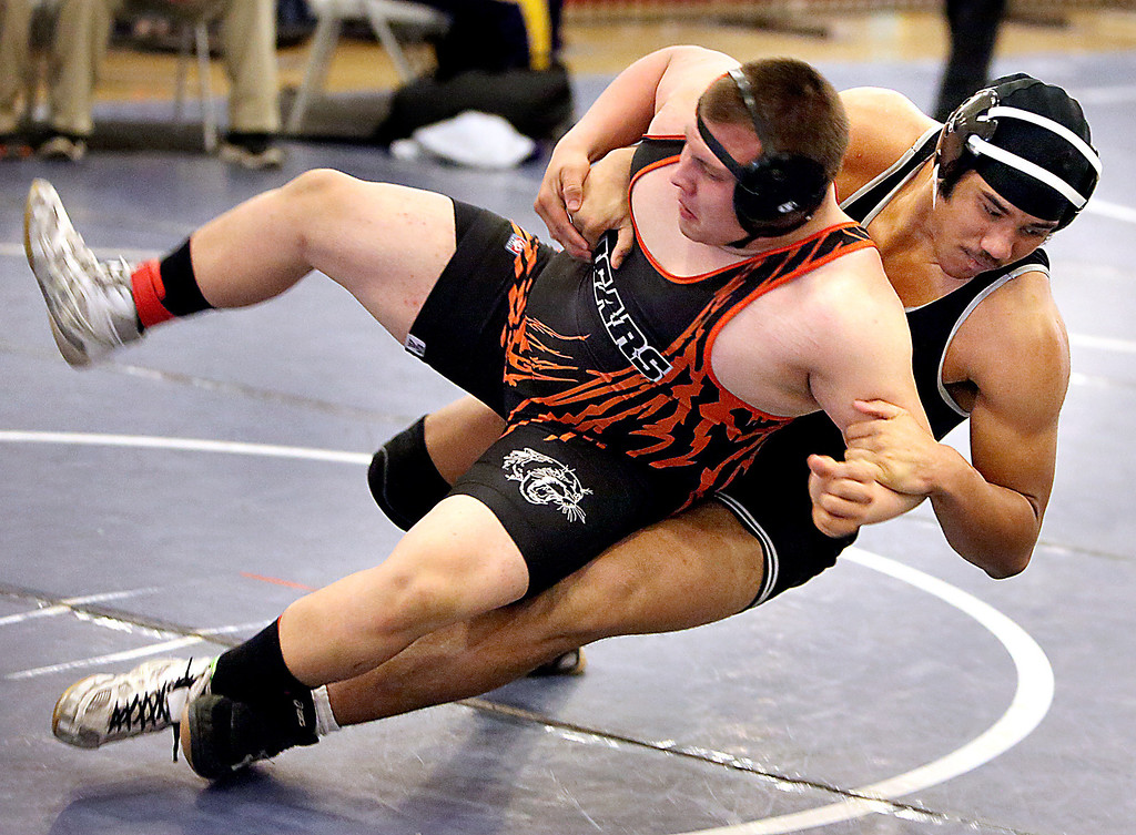 . Harbor High senior Dakota Francis throws his opponent to the mat during his match at the Central Coast Section Wrestling Tournament at Independence High in San Jose, Calif., on Friday, Feb. 23, 2013. (Kevin Johnson/Sentinel)