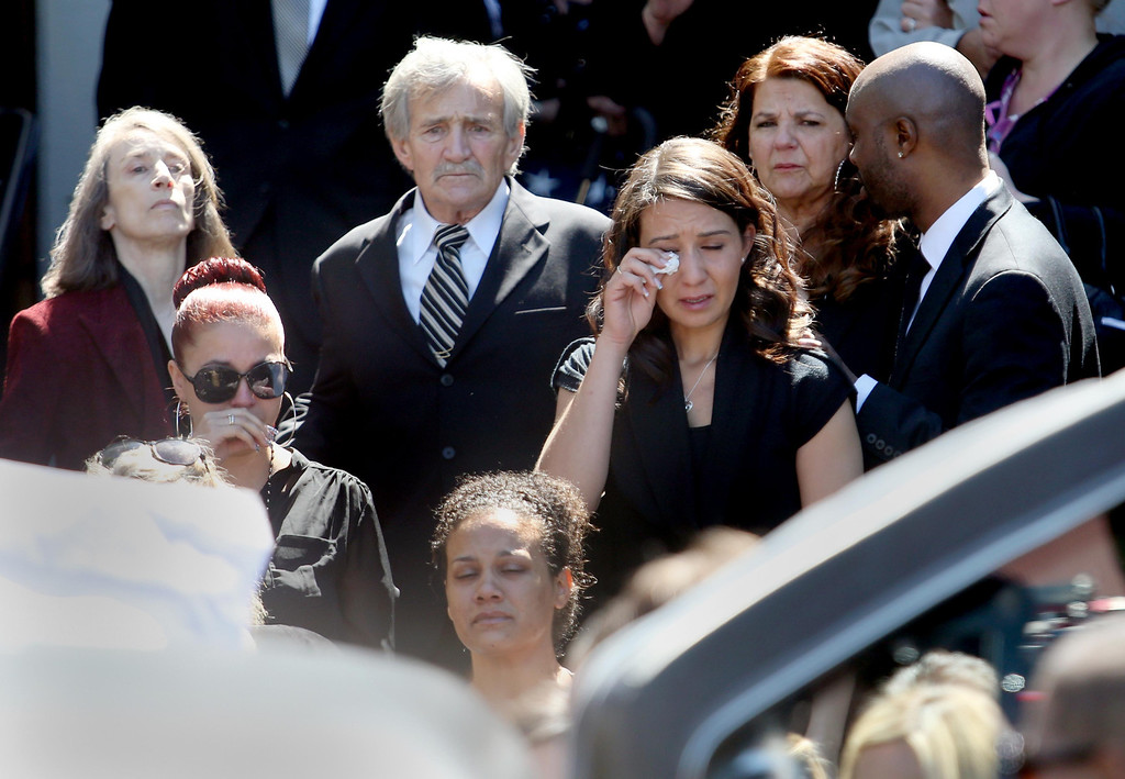 . Roger Boyer, of Oakland, center left,  and others follow the casket to the hearse during funeral services for his son and Santa Clara paramedic Quinn Boyer, 34, of Dublin, at St. Theresa Catholic Church in Oakland, Calif., on Tuesday, April 16, 2013.  (Jane Tyska/Staff)