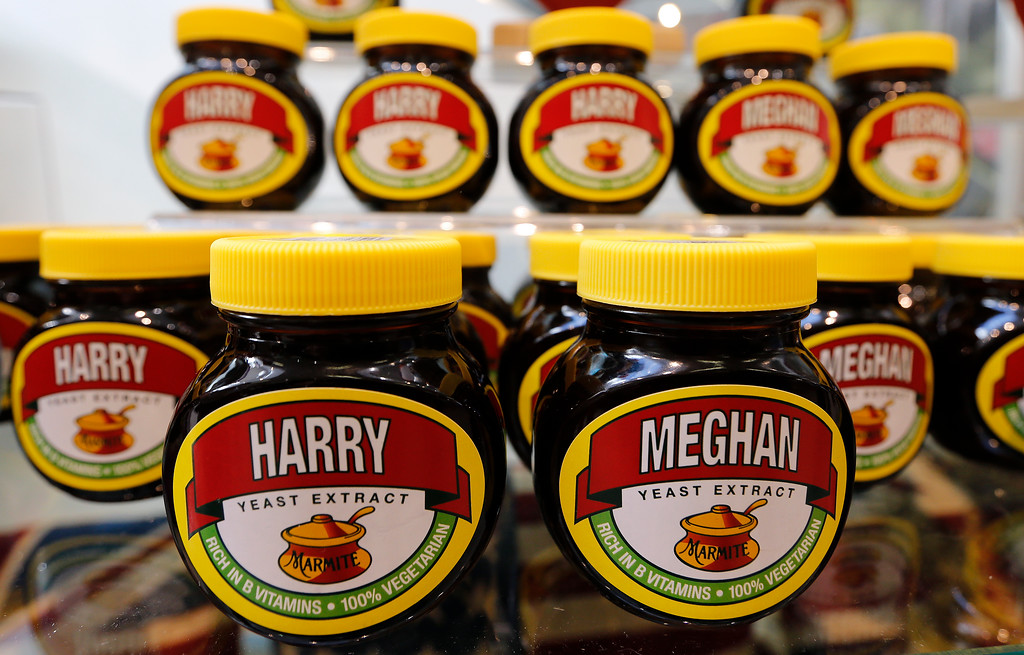 . Marmite jars with the names of Harry and Meghan on it are seen on a supermarket shelf in Windsor, Tuesday, May 15, 2018. Marmite is a traditional English bread spread. Preparations are being made in the town ahead of the wedding of Britain\'s Prince Harry and Meghan Markle that will take place in Windsor on Saturday May 19.(AP Photo/Frank Augstein)