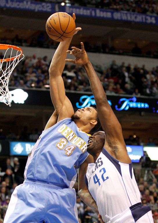 . Denver Nuggets center JaVale McGee (L) beats Dallas Mavericks forward Elton Brand to a rebound during the first half of their NBA basketball game in Dallas, Texas, December 28, 2012.  REUTERS/Mike Stone