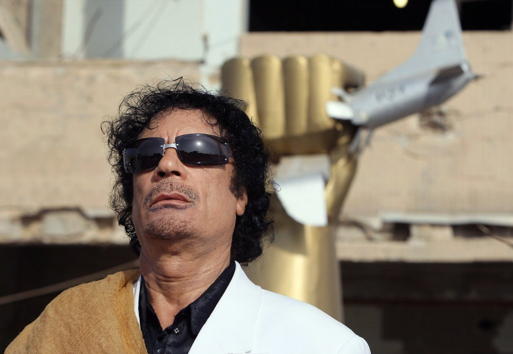 """. <p><b> A new documentary about the late Moammar Gadhafi details how the brutal Libyan dictator regularly used � </b> <p> A. Sex slaves <p> B. Viagra <p> C. Sex slaves and Viagra <p><b><a href=\'http://www.bbc.co.uk/programmes/galleries/p01qr9xp\' target=\""""_blank\"""">HUH?</a></b> <p>    (Patrick Kovarik/AFP/Getty Images)"""