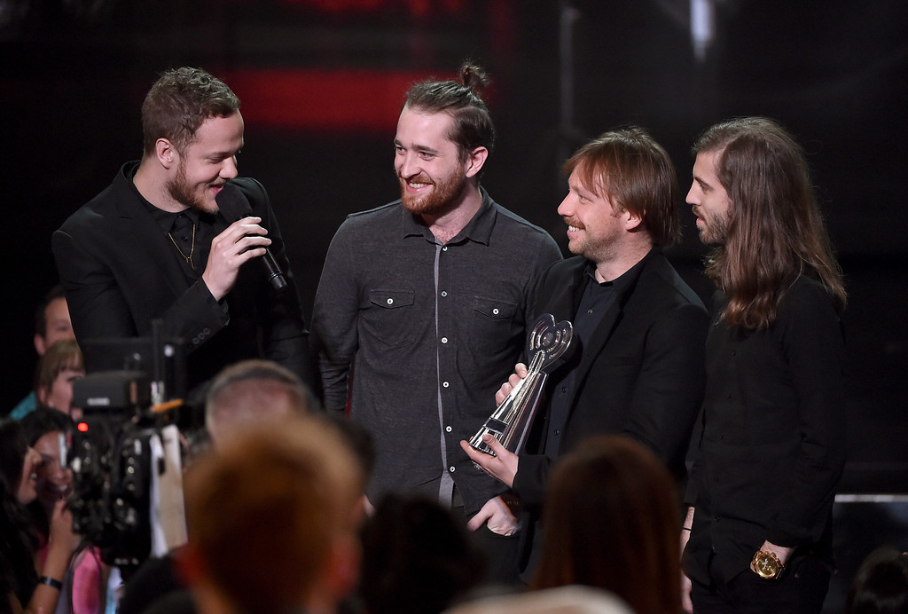. LOS ANGELES, CA - MAY 01:  (L-R) Musicians Dan Reynolds, Daniel Platzman, Ben McKee, and Wayne Sermon of Imagine Dragons accept the Alternative Rock Song of the Year award for \'Demons\' onstage during the 2014 iHeartRadio Music Awards held at The Shrine Auditorium on May 1, 2014 in Los Angeles, California. iHeartRadio Music Awards are being broadcast live on NBC.  (Photo by Kevin Winter/Getty Images for Clear Channel)