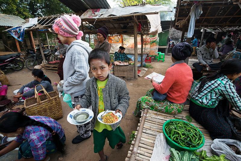 boy in a food market in Bagan.  Bagan,Myanmar,2017