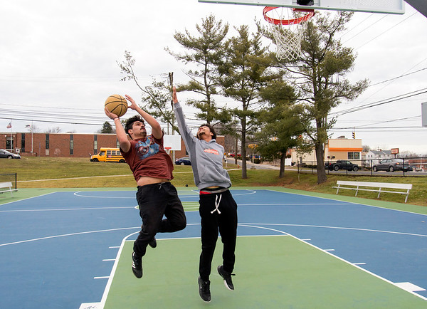 01/14/20 Wesley Bunnell | StaffrrFriends Chris Nieves, L, and Omar Williams play a game of basketball in the renovated Chesley Park on Tuesday afternoon January 14, 2019 with the park getting good reviews for all of the recent renovations including a new basketball surface.