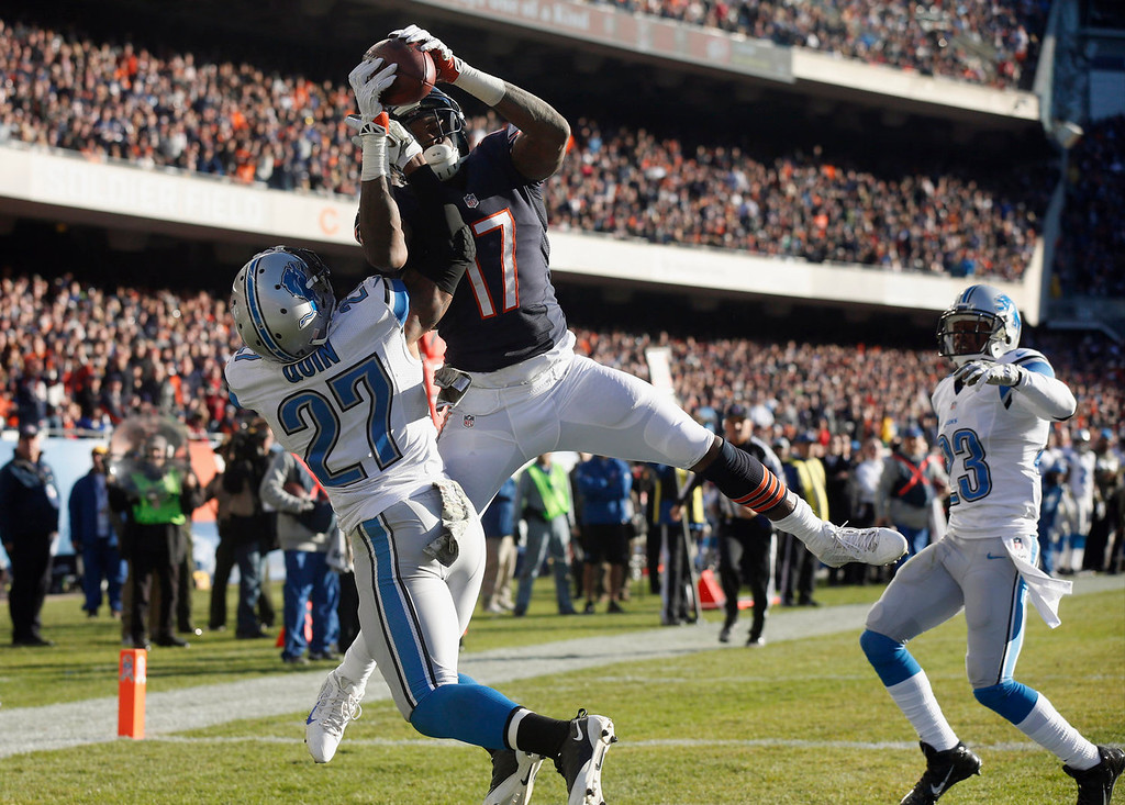 . Chicago Bears wide receiver Alshon Jeffery (17) attempts to make a catch in the end zone against Detroit Lions safety Glover Quin (27) during the second half of an NFL football game, Sunday, Nov. 10, 2013, in Chicago. The play was ruled an incomplete pass.. (AP Photo/Charles Rex Arbogast)