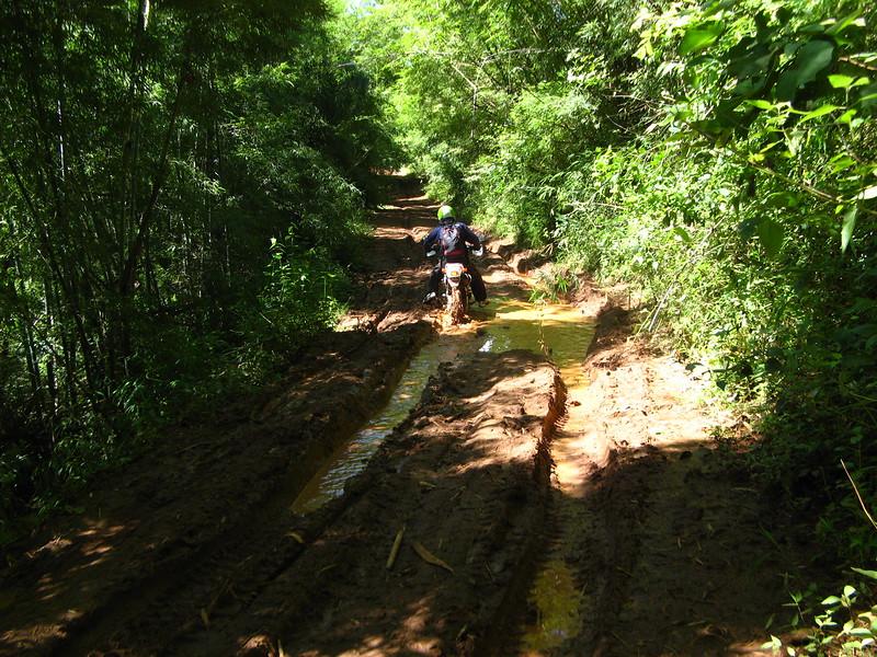 Sa-ngiam climbs a mudding track.