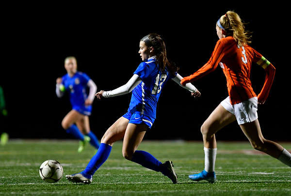 11/19/2019 Mike Orazzi | StaffrSouthington High Schools Maya Wroblewski (13) and Ridgefield High Schools Carolyn Donovan r(3) during the Class LL Semifinal Girls Soccer match at Naugatuck High School Tuesday night. Southington advanced to the final 1-0.