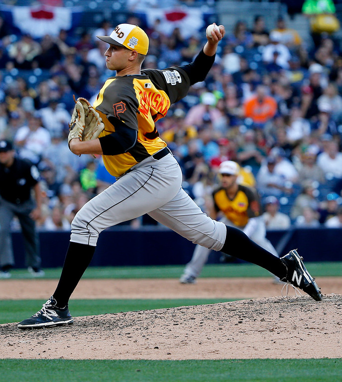 . World Team pitcher Dovydas Neverauskas, of the Pittsburgh Pirates, throws against the U.S. Team during the sixth inning of the All-Star Futures baseball game, Sunday, July 10, 2016, in San Diego. (AP Photo/Lenny Ignelzi)