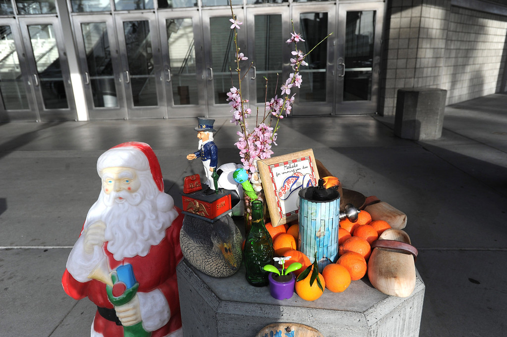 . An impromptu shrine is photographed in front of the HP Pavilion in San Jose, Calif. on Thursday, March 7, 2013. Thousands are expected at the pavilion to mourn the loss of the two Santa Cruz police officers who lost their their lives in the line of duty last Tuesday. (Dan Honda/Staff)