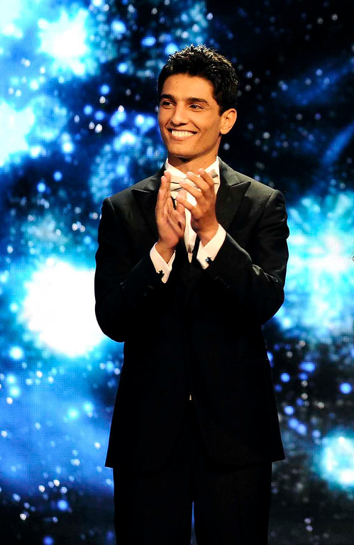 . Singer Mohammed Assaf is seen on the Arab Idol stage in Beirut, Lebanon. On Saturday, June 22, 2013, Assaf became the first Palestinian to win the Arab world\'s version of American Idol, setting off wild celebrations across the Palestinian territories. After the victory, Palestinian President Mahmoud Abbas declared the singer an honorary ambassador.  (AP Photo/MBC Group)