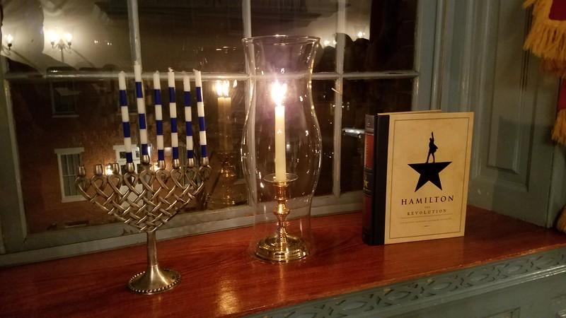 Hanukkiah (Hanukkah Menorah) (l) and Hamilton: The Revolution< (r)