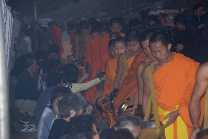 CLose-up shot of monks during alms giving ceremony in Luang Prang, Laos