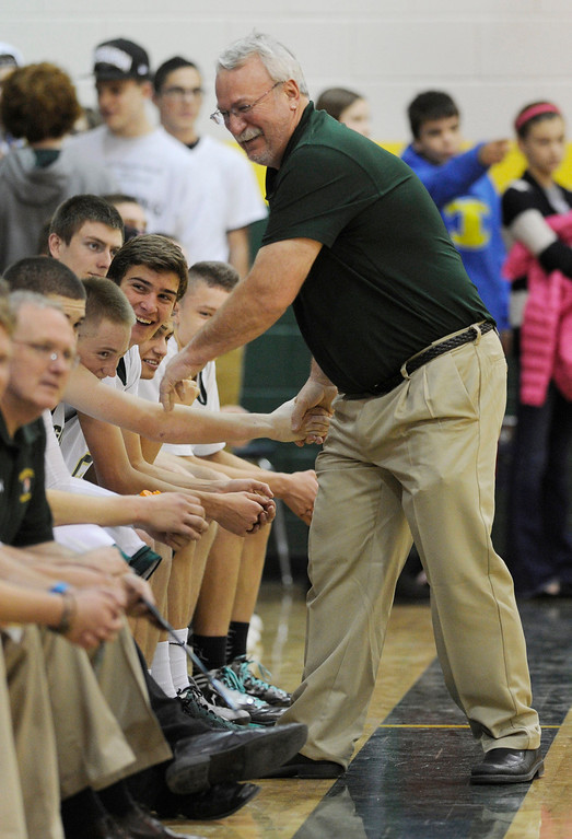 . Mountain Vista coach Bob Wood shook hands with players at the end of the game. The Mountain Vista High School boy\'s basketball team defeated Arapahoe 69-54 Friday night January 4, 2013.  Karl Gehring/The Denver Post