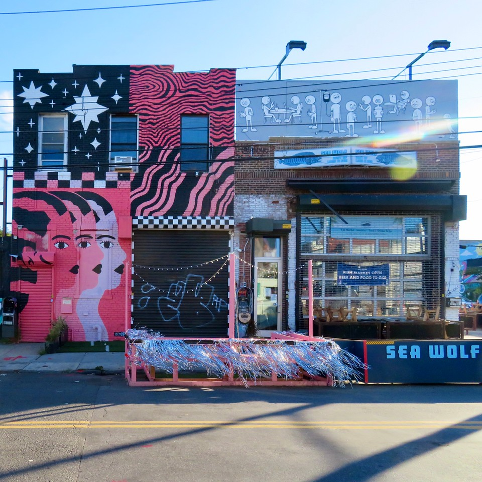 street art painted buildings sea wolf in bushwick brooklyn street scene