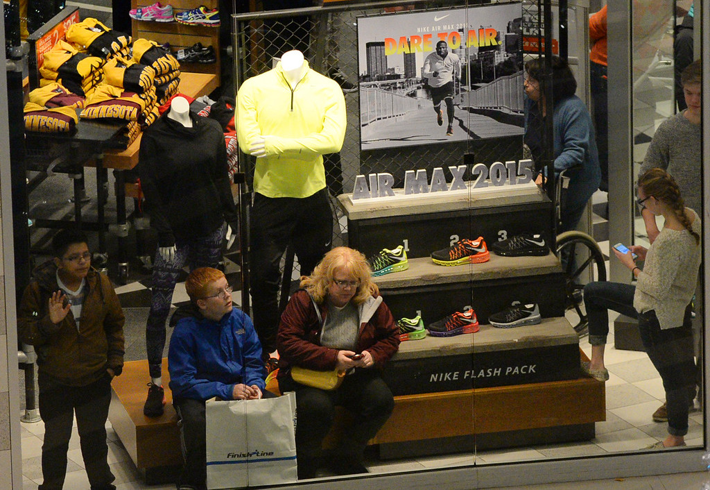 . Shoppers are stuck in a store while officials clear protesters from the area. (Pioneer Press: John Autey)