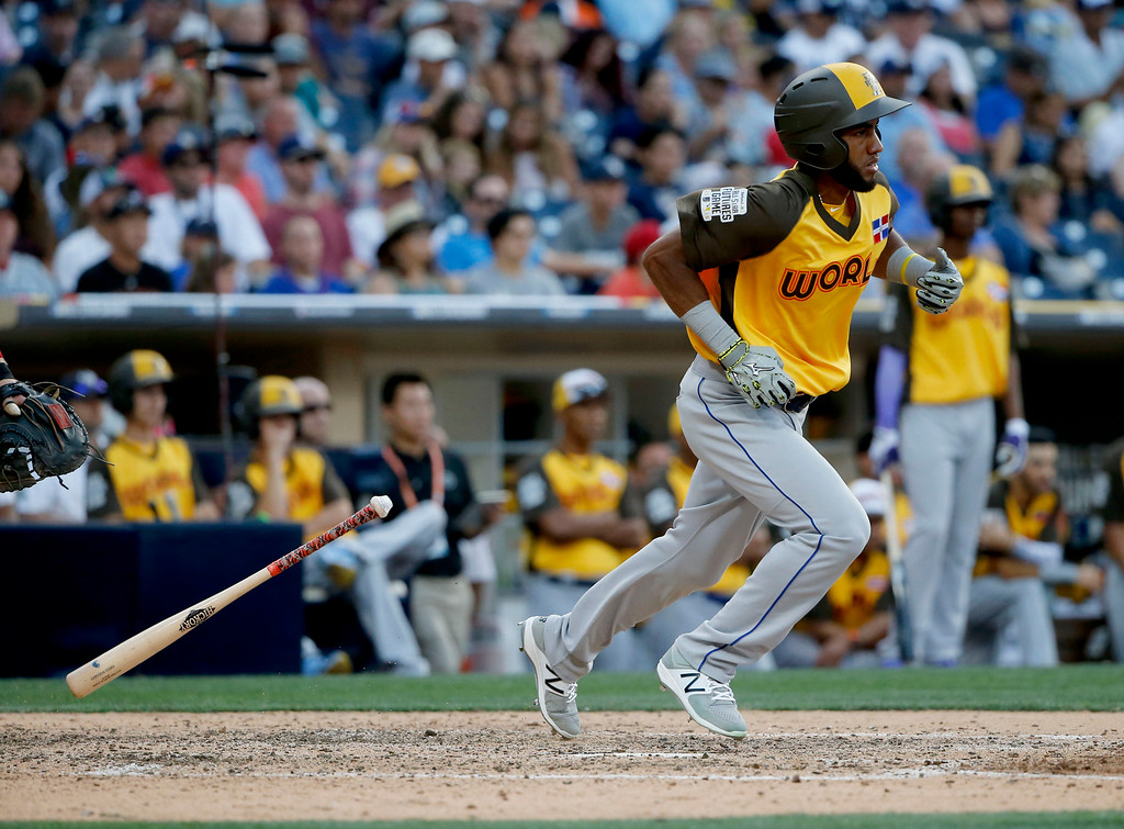 . World Team\'s Amed Rosario runs out a base hit against the U.S. Team during the ninth inning of the All-Star Futures baseball game, Sunday, July 10, 2016, in San Diego. (AP Photo/Lenny Ignelzi)