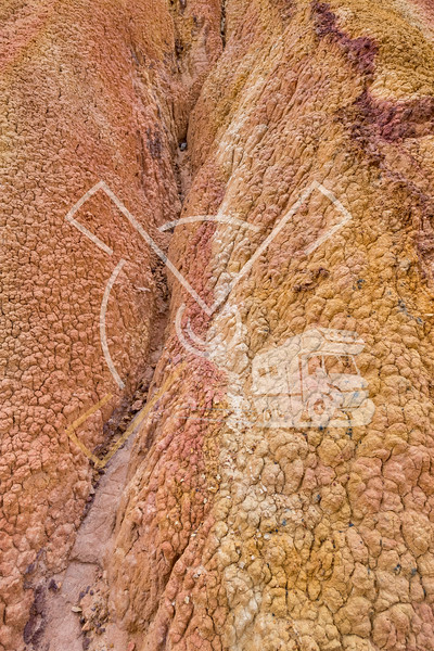 "Detail of eroded mud in badland valley in the red sandstone landscape at the ""Fairy tale canyon"""