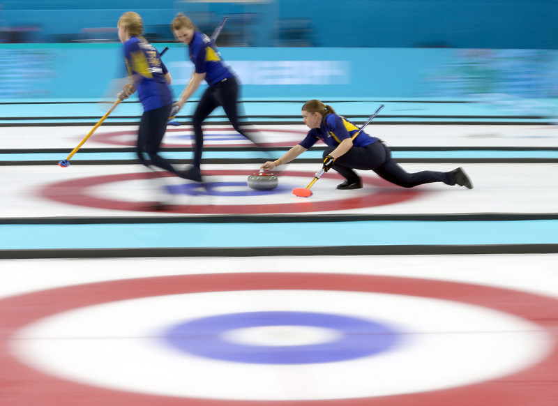 . Maria Wennerstroem (R) of Sweden delivers a stone during the Women\'s Gold medal match between Sweden and Canada in the Curling competition in the Ice Cube Curling Center at the Sochi 2014 Olympic Games, Sochi, Russia, 20 February 2014.  EPA/TATYANA ZENKOVICH