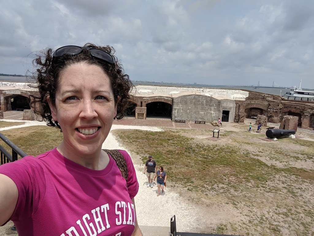 Lisa at Fort Sumter, SC, June 2019, with Charleston in the distance