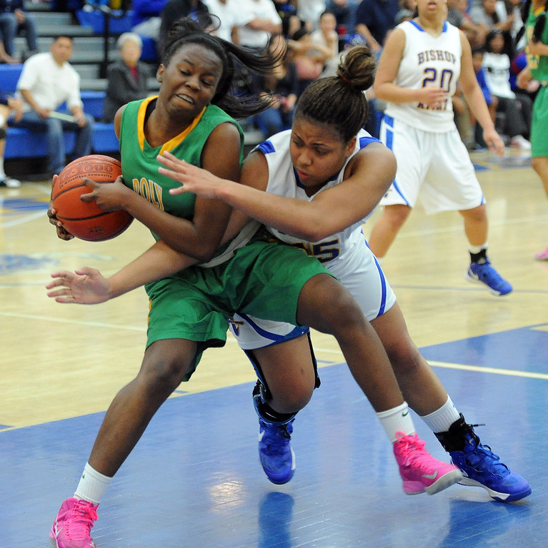 . Long Beach Poly\'s Tania Lamb fights for the ball against Bishop Amat\'s Leeah Powell in the first half of a CIF State Southern California Regional semifinal basketball game at Bishop Amat High School on Tuesday, March 12, 2013 in La Puente, Calif. Long Beach Poly won 52-34.  (Keith Birmingham Pasadena Star-News)
