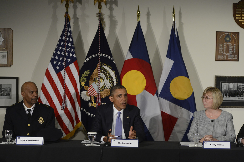 . DENVER, CO. - APRIL 03: President Barack Obama is flanked by Denver Police Chief, Robert White, left, and Sandy Phillips during a round table discussion at the Denver Police Academy in Denver, CO April 03, 2013. The meeting took place before a forum with law enforcement officials and community leaders.   (Photo By Craig F. Walker/The Denver Post)