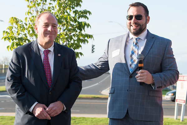 05/15/19 Wesley Bunnell | Staff The Greater New Britain Chamber of Commerce @ Tomasso Group held an after business party with food and drinks and networking before unveiling their signature bee which is part of Bees Across New Britain. New Britain Chamber of Commerce Interim President Kyle Kummer, speaks to the crowd while standing next to Tomasso Group's William Tomasso.