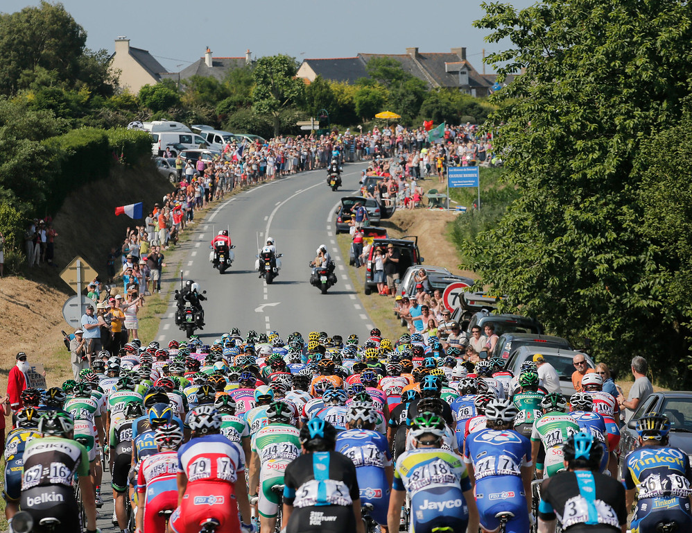 . The pack rides during the tenth stage of the Tour de France cycling race over 197 kilometers (123.1 miles) with start in in Saint-Gildas-des-Bois and finish in Saint-Malo, Brittany region,  western France, Tuesday July 9 2013. (AP Photo/Christophe Ena)