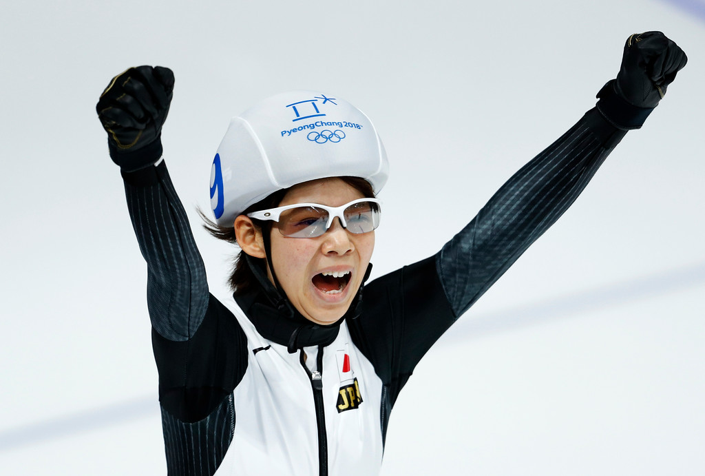 . Gold medalist Nana Takagi of Japan celebrates the women\'s mass start final speedskating race at the Gangneung Oval at the 2018 Winter Olympics in Gangneung, South Korea, Saturday, Feb. 24, 2018. (AP Photo/John Locher)