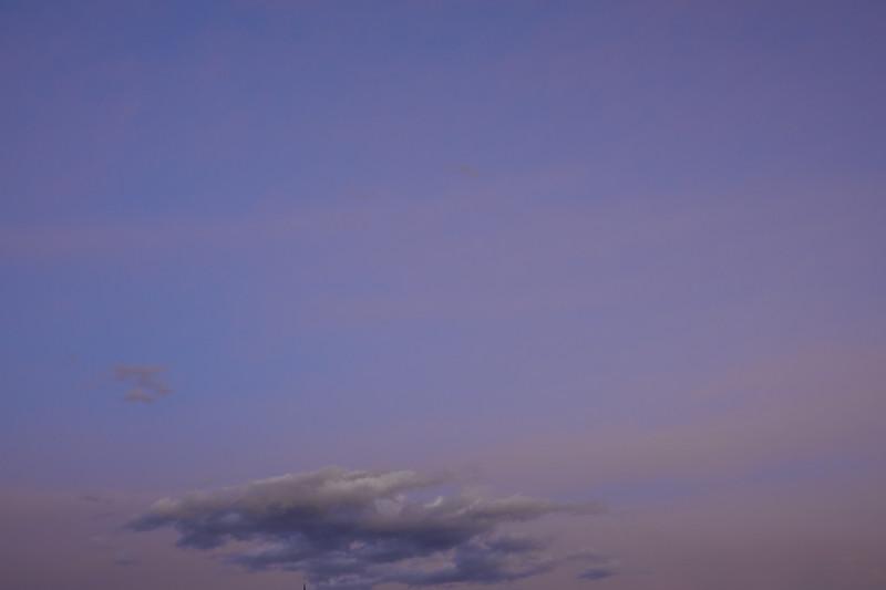 Just a few clouds low on the horizon while the setting sun lights the sky purple