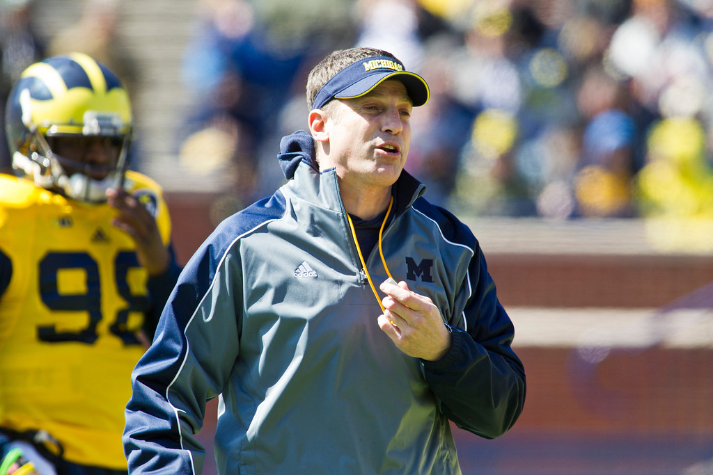 . Michigan offensive coordinator Doug Nussmeier handles his whistle around his neck, during the football team\'s annual spring game, Saturday, April 5, 2014, in Ann Arbor, Mich. (AP Photo/Tony Ding)